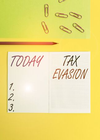 Handwriting text writing Tax Evasion. Conceptual photo the failure to pay or the deliberate underpayment of taxes Blank squared notebook pencil marker paper sheet plain colored background