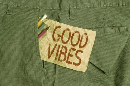 Word writing text Good Vibes. Business photo showcasing slang phrase for the positive feelings given off by a demonstrating Writing equipment and brown note paper inside pocket of man work trousers