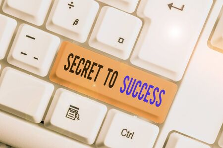 Text sign showing Secret To Success. Business photo text Unexplained attainment of fame wealth or social status White pc keyboard with empty note paper above white background key copy space