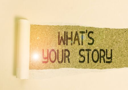 Conceptual hand writing showing What S Your Story. Concept meaning asking someone tell me about himself Share experience Cardboard which is torn placed above a wooden classic table