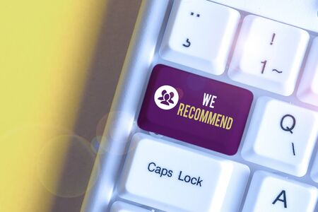 Text sign showing We Recommend. Business photo text suggest that someone or something would be good or suitable White pc keyboard with empty note paper above white background key copy space Stockfoto