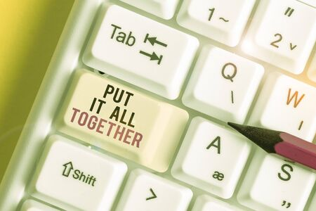 Handwriting text Put It All Together. Conceptual photo Join Collectively Unified Integrated Linked Merge White pc keyboard with empty note paper above white background key copy space