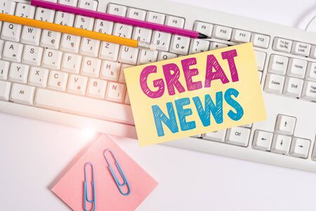 Conceptual hand writing showing Great News. Concept meaning someone or something that is positive encouraging and uplifting White keyboard with note paper and clips on white background