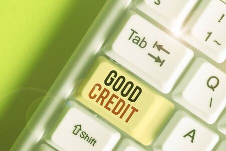 Writing note showing Good Credit. Business concept for borrower has a relatively high credit score and safe credit risk