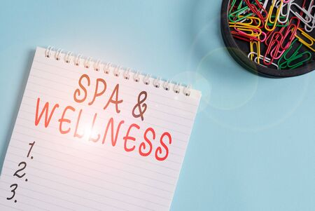 Writing note showing Spa And Wellness. Business concept for Place where showing go to improve their health Relaxation Blank empty notebook and stationary placed above pastel colour backdrop