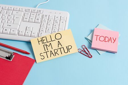 Word writing text Hello I M A Startup. Business photo showcasing Entrepreneur starting business Presenting New project Paper blue desk computer keyboard office study notebook chart numbers memo