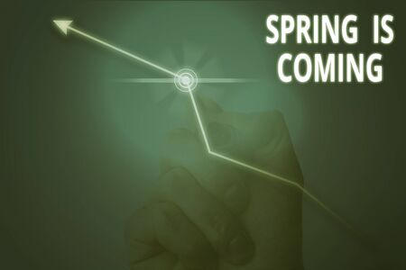 Conceptual hand writing showing Spring Is Coming. Concept meaning After winter season is approaching Enjoy nature flowers sun