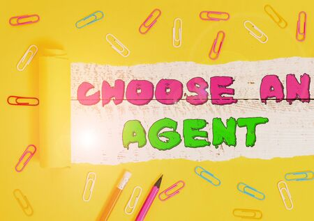Word writing text Choose An Agent. Business photo showcasing Choose someone who chooses decisions on behalf of you Stationary and torn cardboard placed above a wooden classic table backdrop