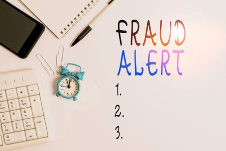 Conceptual hand writing showing Fraud Alert. Concept meaning security alert placed on credit card account for stolen identity Business concept with space for advertising and text message Reklamní fotografie