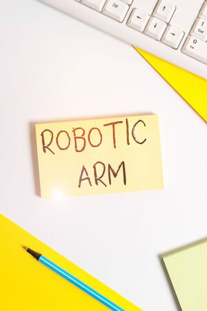 Text sign showing Robotic Arm. Business photo showcasing programmable mechanical arm with similar function of a huanalysis arm Flat lay above table with pc keyboard and copy space paper for text messa