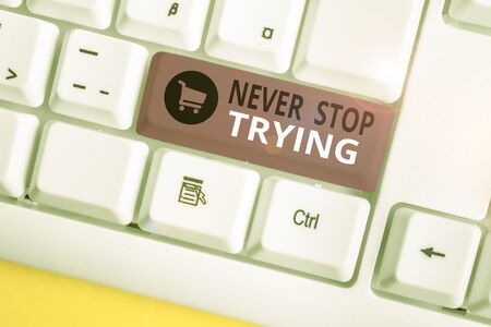 Writing note showing Never Stop Trying. Business concept for Do not give up Continue to Try Again Keep on Doing White pc keyboard with note paper above the white background Stock fotó