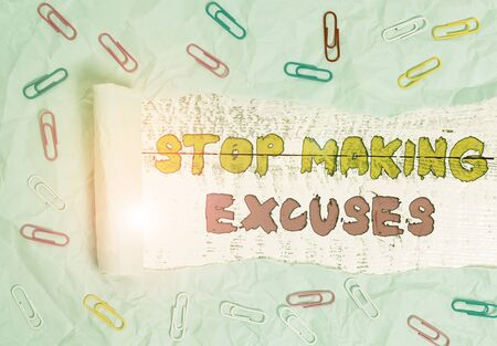 Writing note showing Stop Making Excuses. Business concept for Cease Justifying your Inaction Break the Habit Paper clip and torn cardboard on wood classic table backdrop Archivio Fotografico