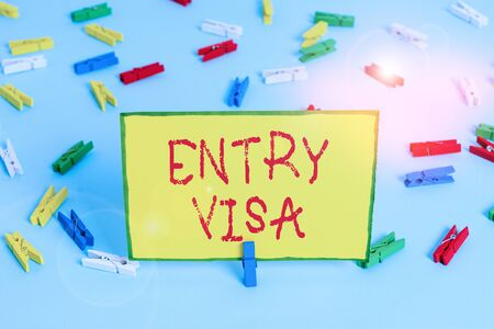 Word writing text Entry Visa. Business photo showcasing permission to enter a country of which you are not a national Colored clothespin papers empty reminder blue floor background office pin Stok Fotoğraf - 133729098
