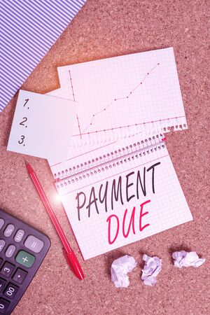 Conceptual hand writing showing Payment Due. Concept meaning The date when payment should be received by the company Desk notebook paper office paperboard study supplies chart