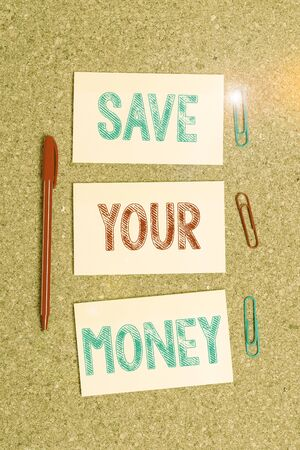 Writing note showing Save Your Money. Business concept for keep your savings in bank or stock to protect it Dont waste Empty sticker reminder memo billboard corkboard desk paper