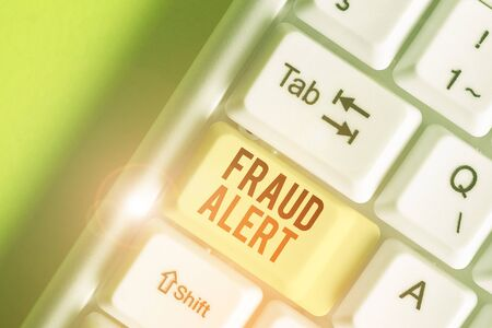 Writing note showing Fraud Alert. Business concept for security alert placed on credit card account for stolen identity Reklamní fotografie