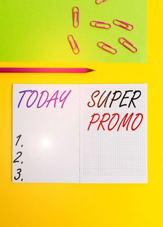 Handwriting text writing Super Promo. Conceptual photo piece of publicity or advertising in the form of a short film Blank squared notebook pencil marker paper sheet plain colored background