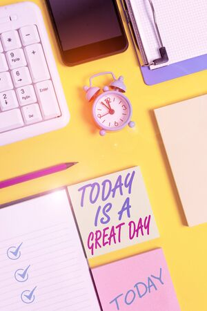 Writing note showing Today Is A Great Day. Business concept for Enjoying the moment great weather Having fun White paper with copy space with paper clips clock and pc keyboard