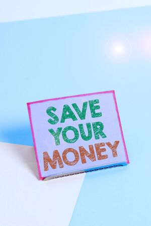 Word writing text Save Your Money. Business photo showcasing keep your savings in bank or stock to protect it Dont waste Paper placed tilted above buffer wire on soft pastel multi colours backdrop