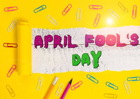 Word writing text April Fool S Day. Business photo showcasing Practical jokes humor pranks Celebration funny foolish Stationary and torn cardboard placed above a wooden classic table backdrop Reklamní fotografie