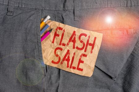 Word writing text Flash Sale. Business photo showcasing a sale of goods at greatly reduced prices at a short period Writing equipment and brown note paper inside pocket of man work trousers Stock fotó