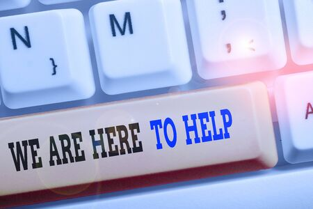Text sign showing We Are Here To Help. Business photo text Someone who is always ready to Assist Support Give Banco de Imagens