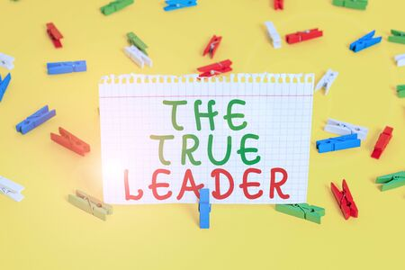 Handwriting text The True Leader. Conceptual photo one that move and encourage group of showing Responsibility Colored clothespin papers empty reminder yellow floor background office