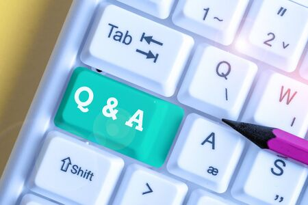 Handwriting text Q And A. Conceptual photo a period of time or an occasion when someone answers questions White pc keyboard with empty note paper above white background key copy space