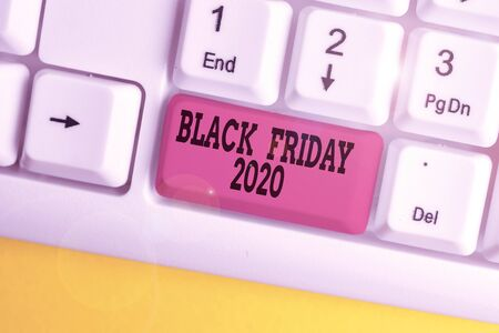 Handwriting text writing Black Friday 2020. Conceptual photo day following Thanksgiving Discounts Shopping day White pc keyboard with empty note paper above white background key copy space