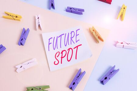 Text sign showing Futuro Spot. Business photo showcasing refers to an action that will take place in the future Colored clothespin paper empty reminder yellow blue floor background office Banque d'images