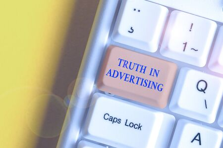 Writing note showing Truth In Advertising. Business concept for Practice Honest Advertisement Publicity Propaganda White pc keyboard with note paper above the white background Imagens