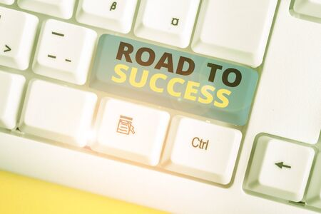 Text sign showing Road To Success. Business photo text studying really hard Improve yourself to reach dreams wishes White pc keyboard with empty note paper above white background key copy space