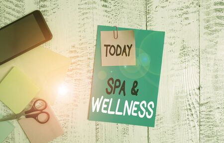 Writing note showing Spa And Wellness. Business concept for Place where showing go to improve their health Relaxation Envelope paper sheet smartphone notepads scissors wooden background