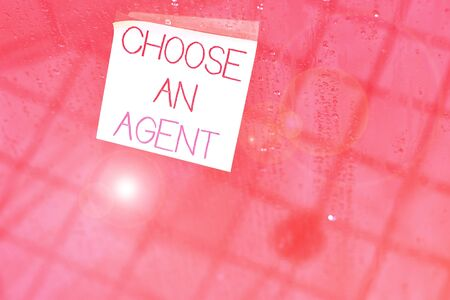 Writing note showing Choose An Agent. Business concept for Choose someone who chooses decisions on behalf of you Square paper piece notation stick to textured glass window