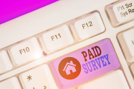 Writing note showing Paid Survey. Business concept for statistical survey where the participants are rewarded or paid Stock Photo