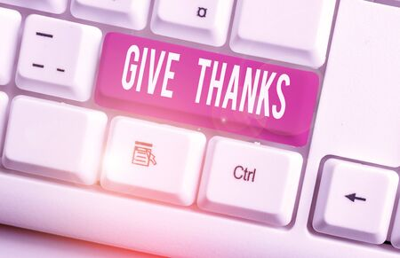 Writing note showing Give Thanks. Business concept for express gratitude or show appreciation Acknowledge the kindness White pc keyboard with note paper above the white background