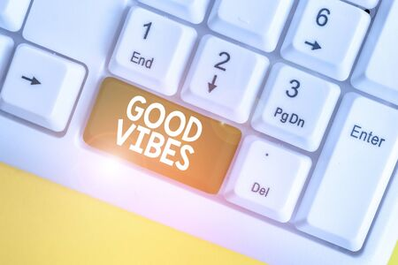 Word writing text Good Vibes. Business photo showcasing slang phrase for the positive feelings given off by a demonstrating White pc keyboard with empty note paper above white background key copy space Stock fotó