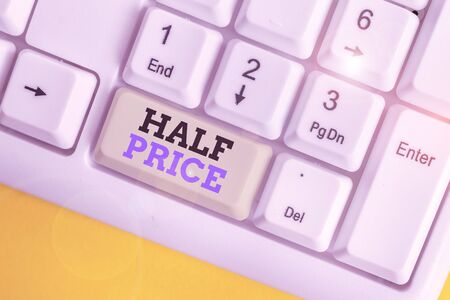 Conceptual hand writing showing Half Price. Concept meaning half the usual price at which something is offered for sale White pc keyboard with note paper above the white background