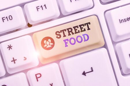 Conceptual hand writing showing Street Food. Concept meaning cooked food sold by vendors in a street or other public location