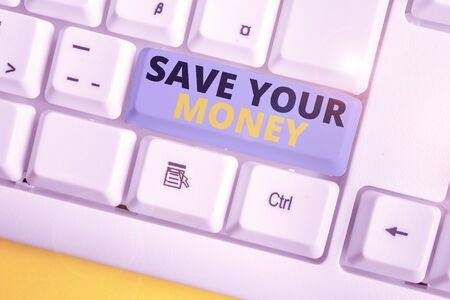 Text sign showing Save Your Money. Business photo text keep your savings in bank or stock to protect it Dont waste White pc keyboard with empty note paper above white background key copy space