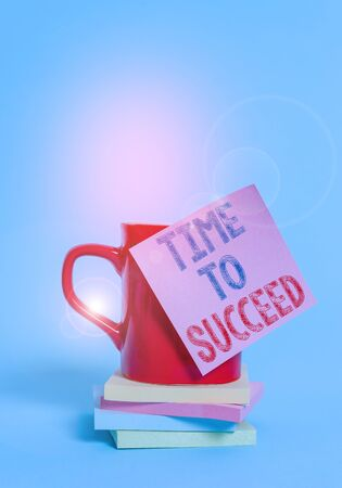 Conceptual hand writing showing Time To Succeed. Concept meaning Thriumph opportunity Success Achievement Achieve your goals Coffee cup colored sticky note stacked pads plain background