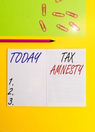 Handwriting text writing Tax Amnesty. Conceptual photo limitedtime opportunity for specified group of taxpayers to pay Blank squared notebook pencil marker paper sheet plain colored background