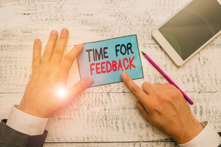 Writing note showing Time For Feedback. Business concept for Need to response or give critic on something Evaluation Hand hold note paper near writing equipment and smartphone Stock fotó