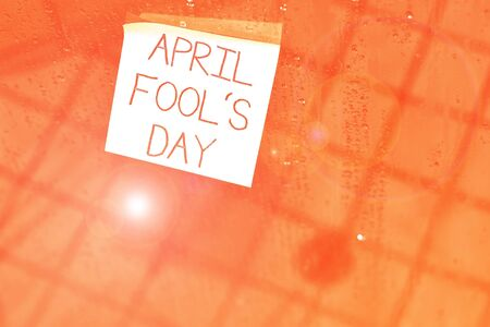 Writing note showing April Fool S Day. Business concept for Practical jokes humor pranks Celebration funny foolish Square paper piece notation stick to textured glass window