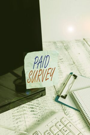 Conceptual hand writing showing Paid Survey. Concept meaning statistical survey where the participants are rewarded or paid Note paper taped to black screen near keyboard stationary