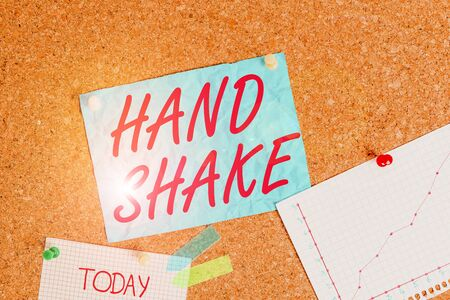 Text sign showing Hand Shake. Business photo showcasing an act showing that you have made an agreement or greeting Corkboard color size paper pin thumbtack tack sheet billboard notice board 写真素材