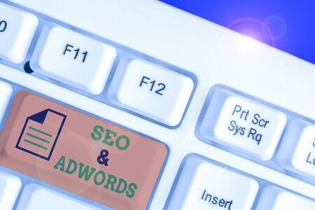 Writing note showing Seo And Adwords. Business concept for Pay per click Digital marketing adsense