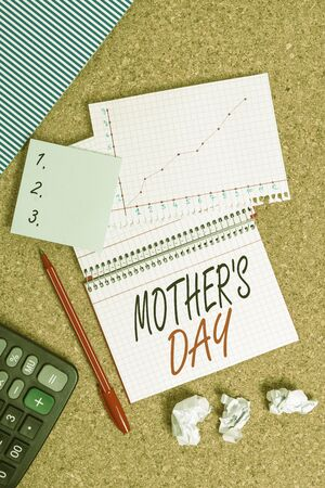 Conceptual hand writing showing Mother S Day. Concept meaning a celebration honoring the mother of the family or motherhood Desk notebook paper office paperboard study supplies chart