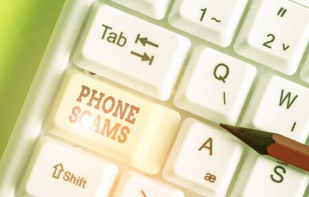 Writing note showing Phone Scams. Business concept for use of telecommunications for illegally acquiring money