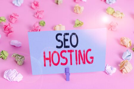 Handwriting text Seo Hosting. Conceptual photo building website in a way that is friendly for search engines Colored crumpled papers empty reminder pink floor background clothespin